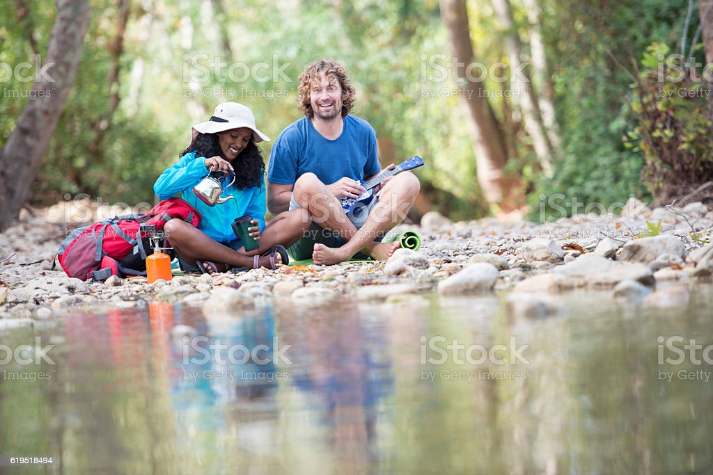 Backpackers coffee break outdoors in nature. stock photo
