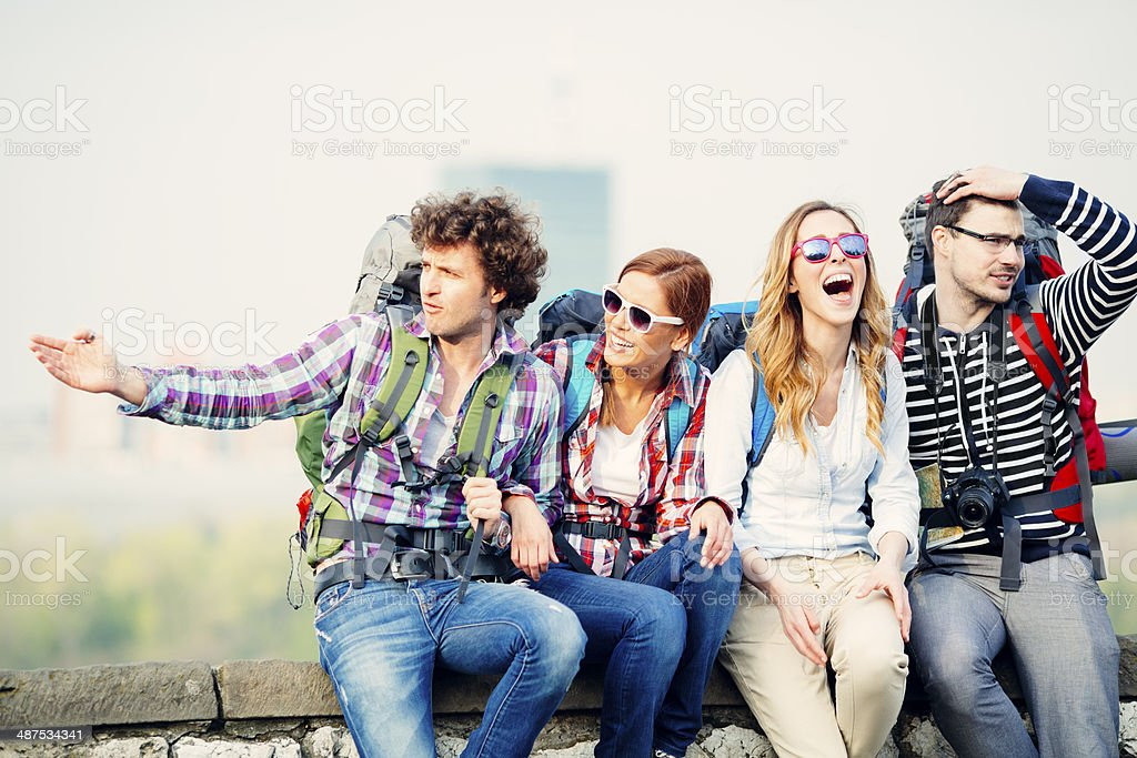 Backpackers having fun on their travel. stock photo