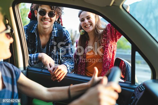 Young backpackers asking information to driver