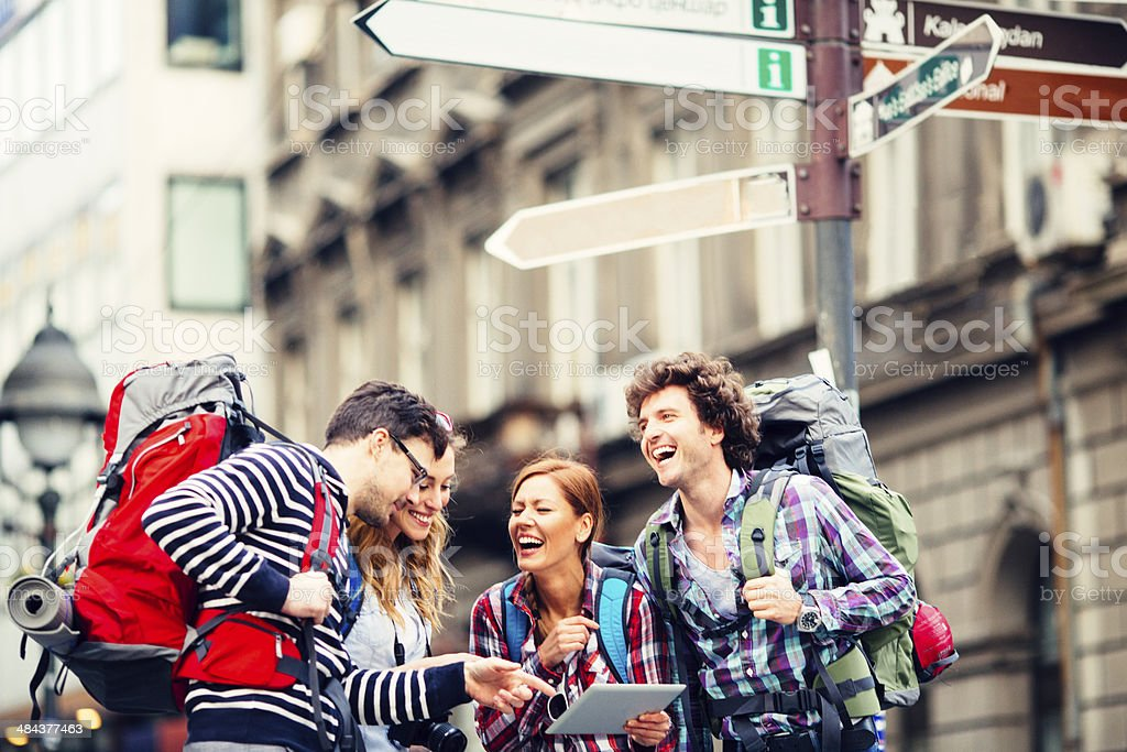 Backpackers in the city stock photo