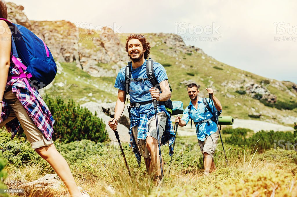 Backpackers on a footpath in the mountain stock photo