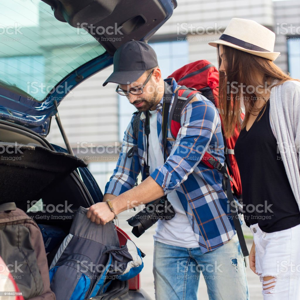 Backpackers on airport stock photo
