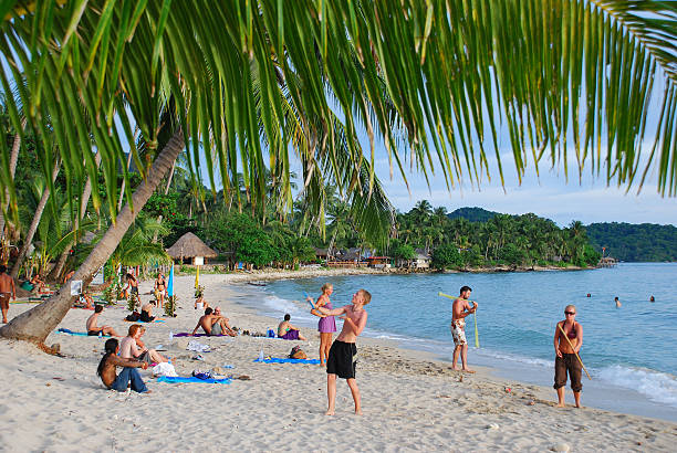 Backpackers on Ko Chang, Thailand Ko Chang, Thailand - June 14, 2007: Backpackers enjoy the relaxed beach life on the island of Ko Chang, off the coast of Trat, Thailand. koh chang stock pictures, royalty-free photos & images