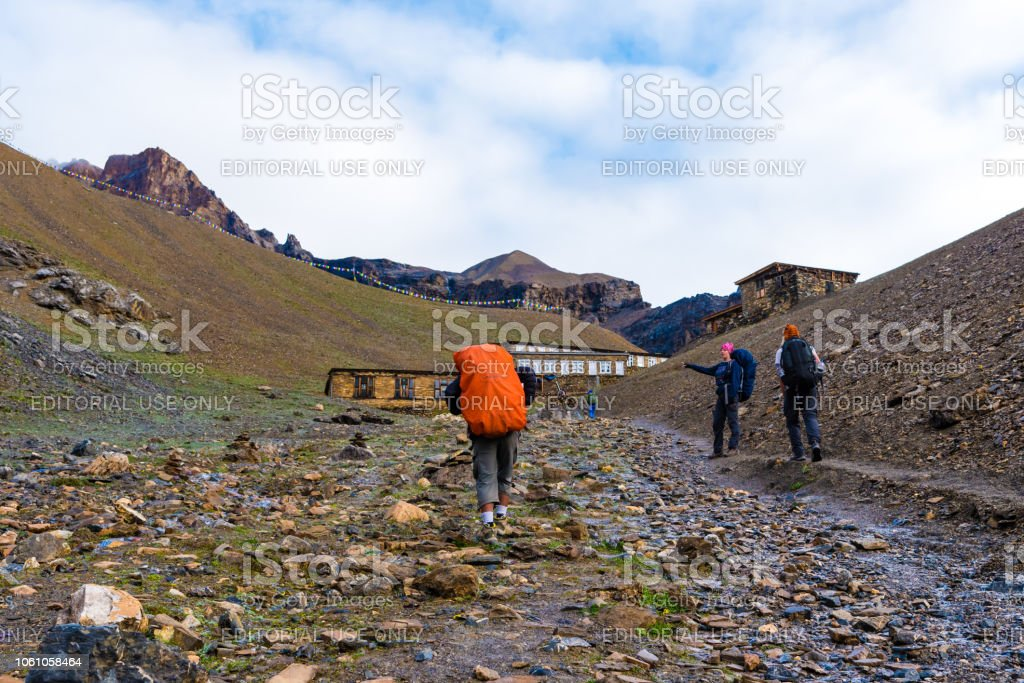 Backpackers on trekking path at Thorang-la pass basecamp, Annapurna Conservation Area, Nepal stock photo