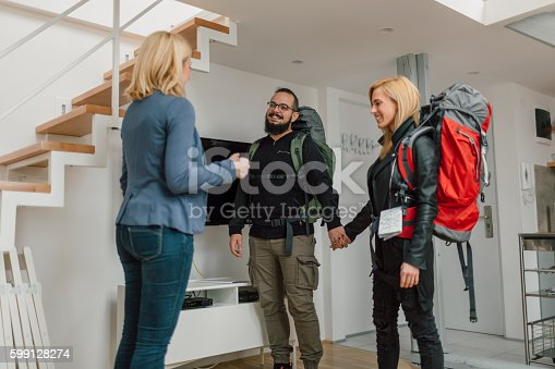 istock Backpackers Renting Apratment. 599128274