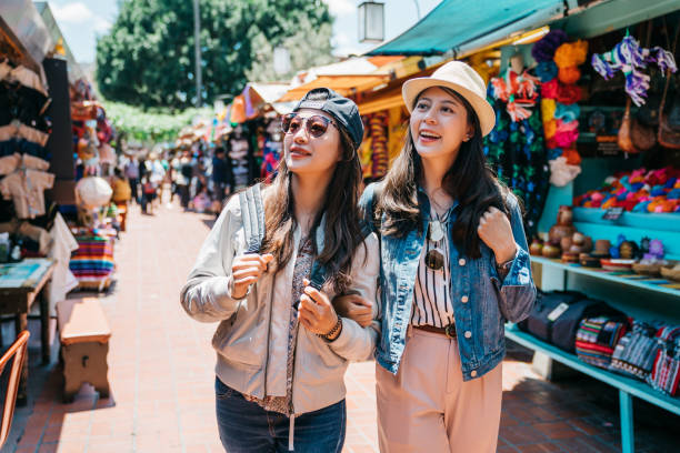backpackers shopping in the Mexican street stock photo