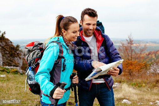 istock Backpackers with map 524623737