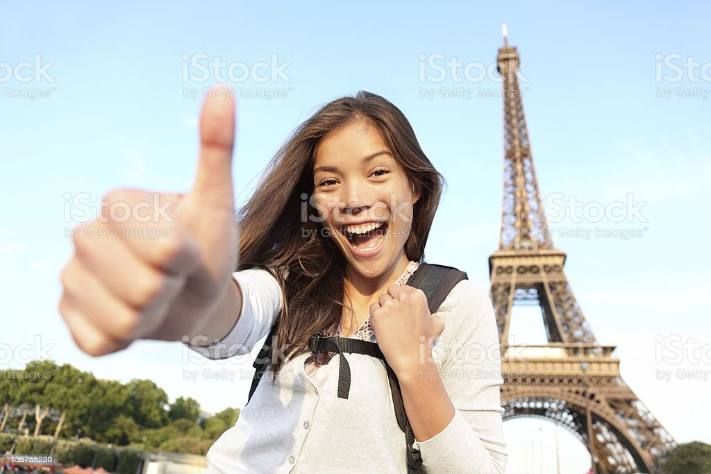 Backpacking Asian female at Eiffel Tower, Paris stock photo