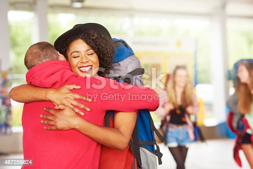 487056916 istock photo Backpacking friends arrive home to loved ones 487259824
