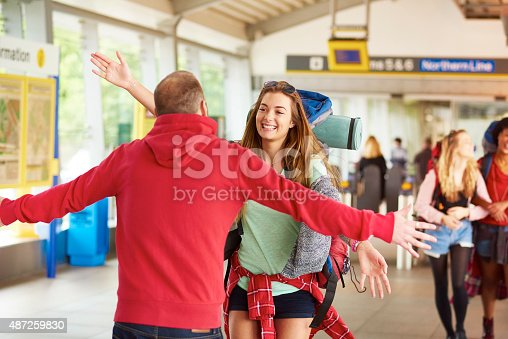 487056916 istock photo Backpacking friends arrive home to loved ones 487259830