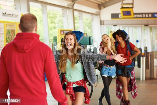 487056916 istock photo Backpacking friends arrive home to loved ones 487259834