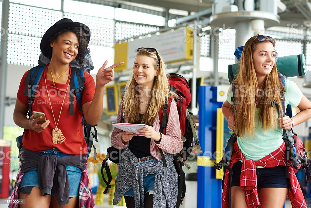Backpacking friends in check map for their next journey route stock photo
