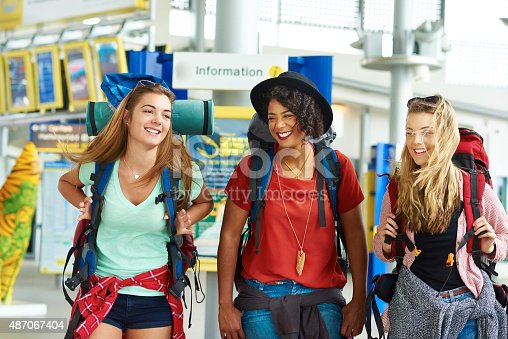 487056916 istock photo Backpacking friends in terminal building 487067404