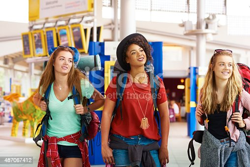 487056916 istock photo Backpacking friends in terminal building 487067412