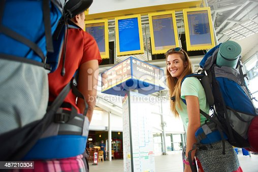 487056916 istock photo Backpacking friends in terminal building 487210304