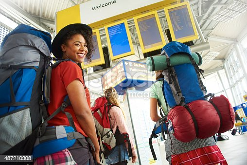 487056916 istock photo Backpacking friends in terminal building 487210308