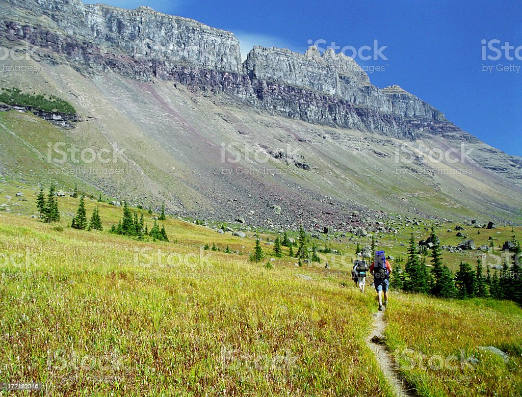 Backpacking Through Field and Mountain royalty-free stock photo