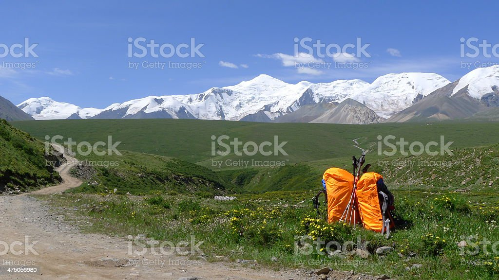 Backpacks and holy snow mountain Anymachen on Tibetan Plateau stock photo