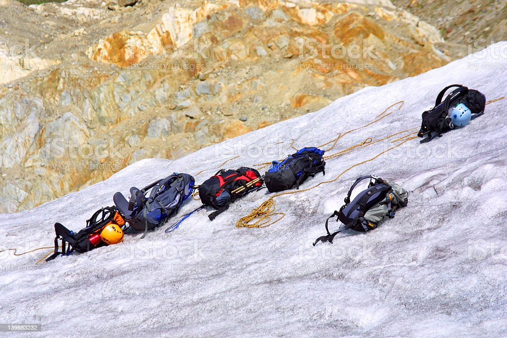 Backpacks on ice - glacier stock photo