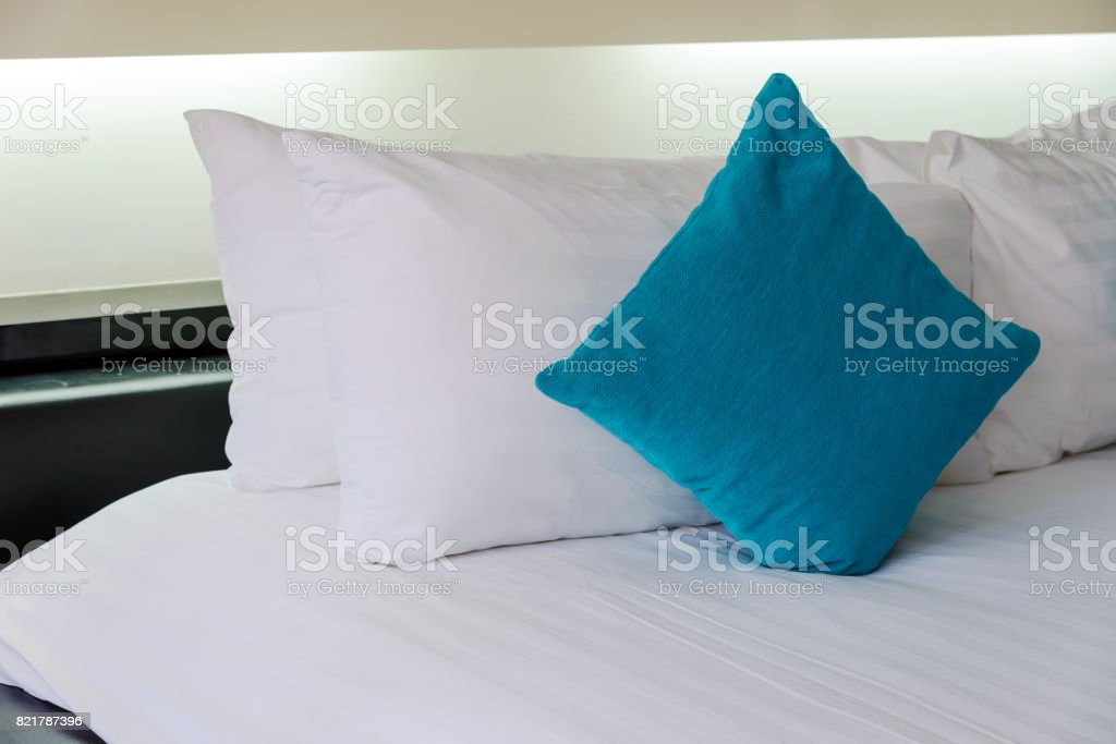 Backrest pillow and pillow on bed in modern bedroom stock photo