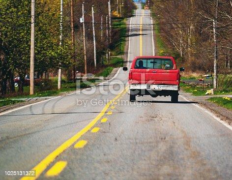 Farm truck on a Nova Scotian backroad in early Spring.