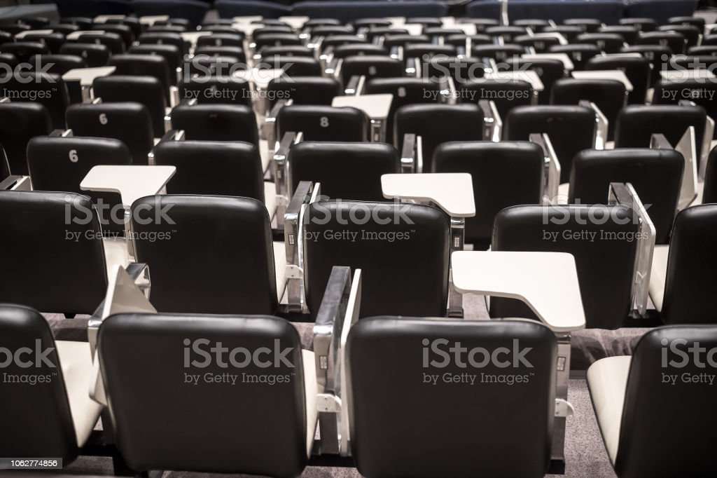 Backs of empty seats in auditorium