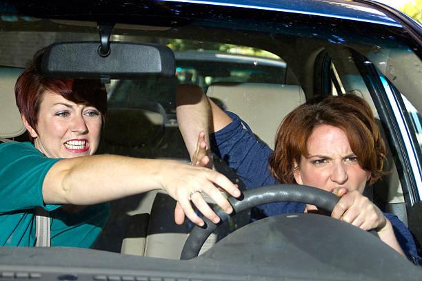 Backseat Driver Passenger Annoying a Female Driver in the Car annoying female passenger by being a