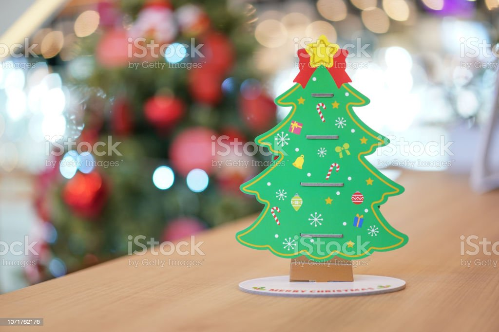 Backside Christmas tree paper craft decoration on the wood table with...