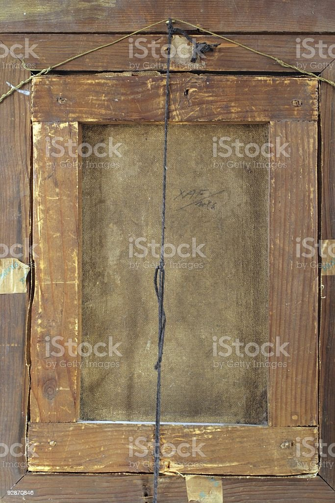 Backside of old painting showing antique wooden frame and string. royalty-free stock photo