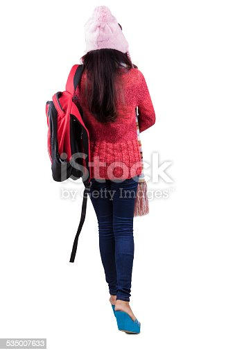 istock Backside of student in winter clothes 535007633