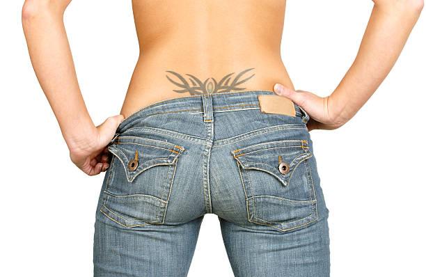 sexy frauen - unterer rücken tattoos stock-fotos und bilder