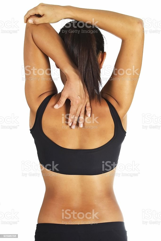 Backside view of a woman stretching out her tricep royalty-free stock photo