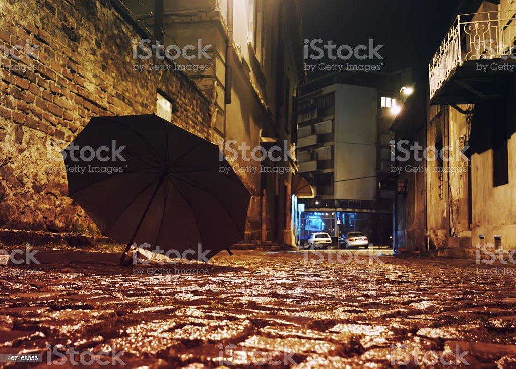 Backstreet and umbrella stock photo