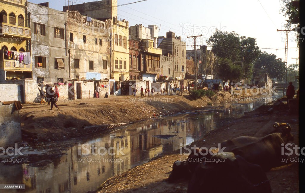 Backstreets along a canal in the old city section of Lahore Pakistan stock photo
