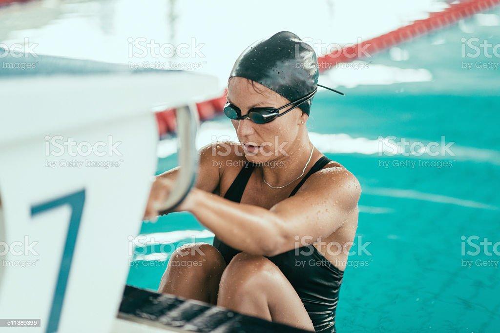 Backstroke swimmer at the race starting block stock photo
