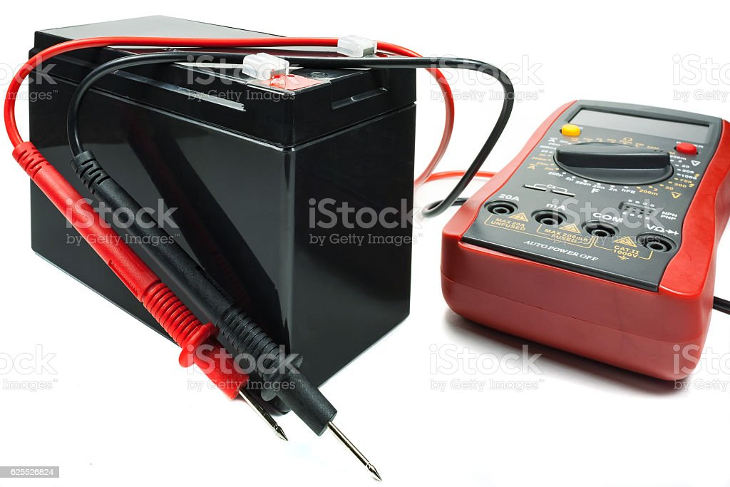 Backup battery with a multimeter and probes stock photo