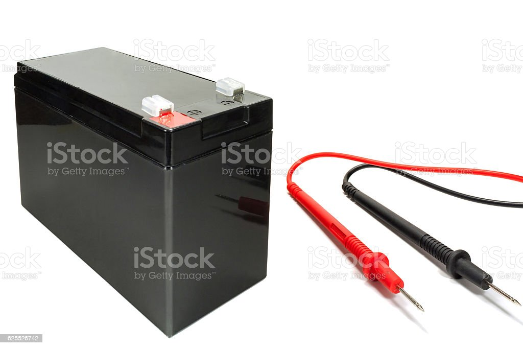 Backup battery with mutimeter probe on a white background stock photo