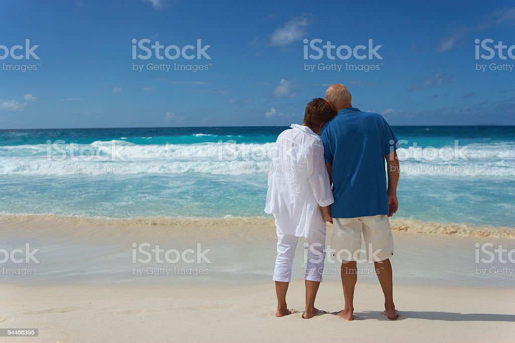 backview of senior couple looking over the sea royalty-free stock photo