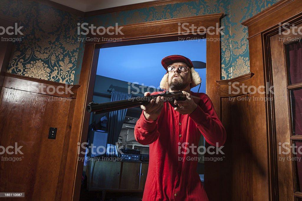 Backwoods Man in Doorway with Shotgun Wearing Long Underwear royalty-free stock photo