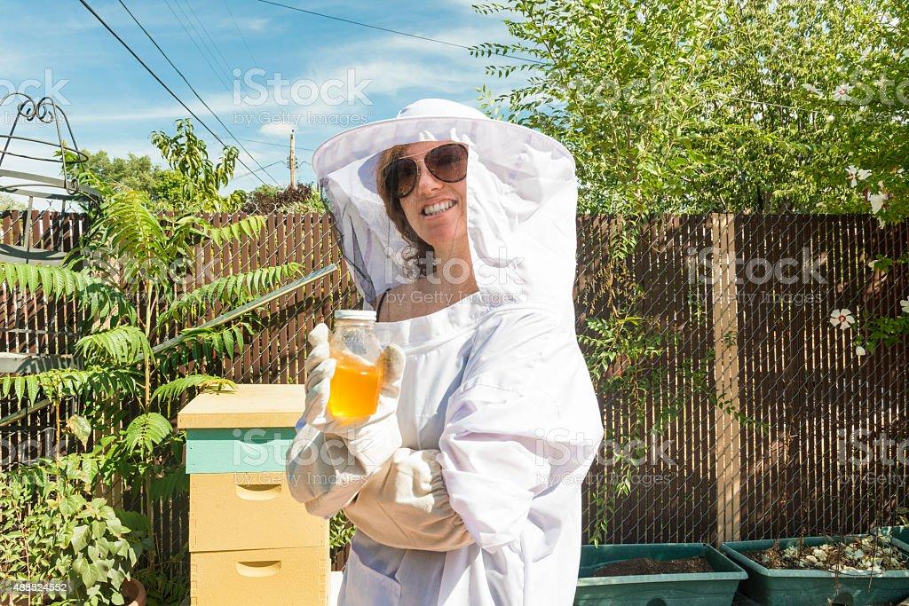 Backyard Beekeeper Holds Organic Local Honey Jar Home Agriculture USA stock photo