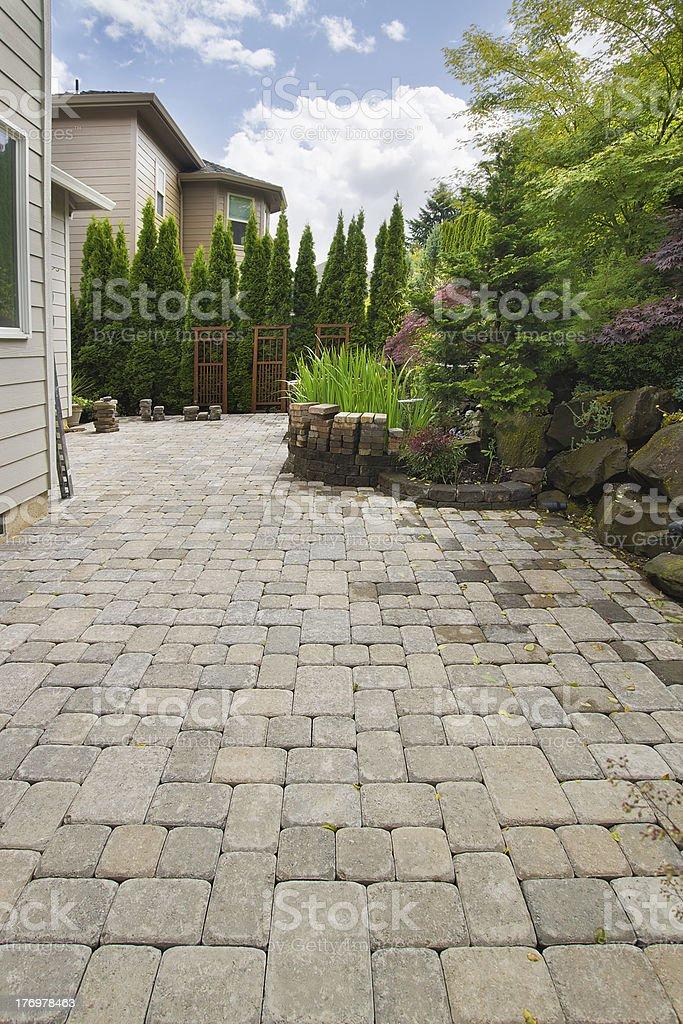 Backyard Brick Paver Patio with Pond stock photo
