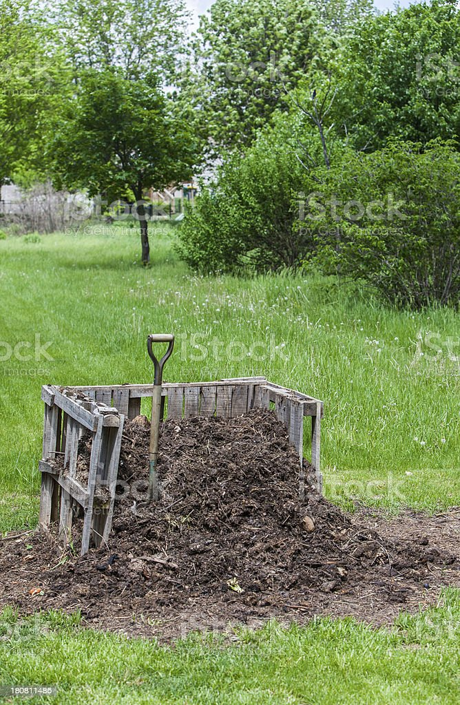 backyard compost pile with copy space vert stock photo