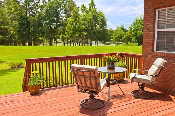 Backyard deck next to a green field