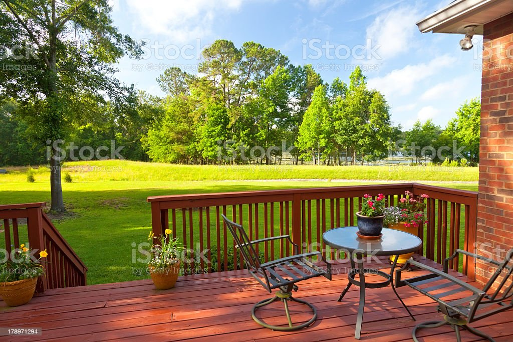 Backyard deck with large green yard stock photo