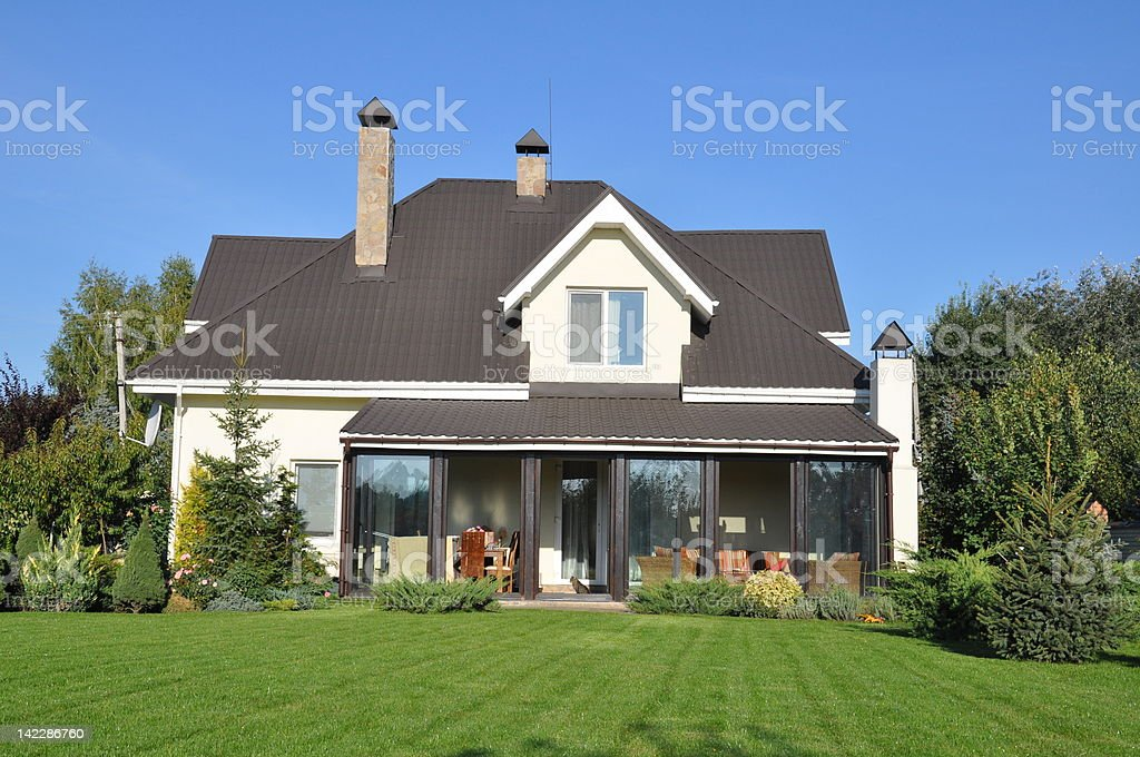 Backyard of a family home with a glass patio royalty-free stock photo
