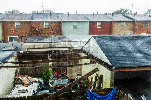 istock Backyard of townhome during rain with junk 623374834