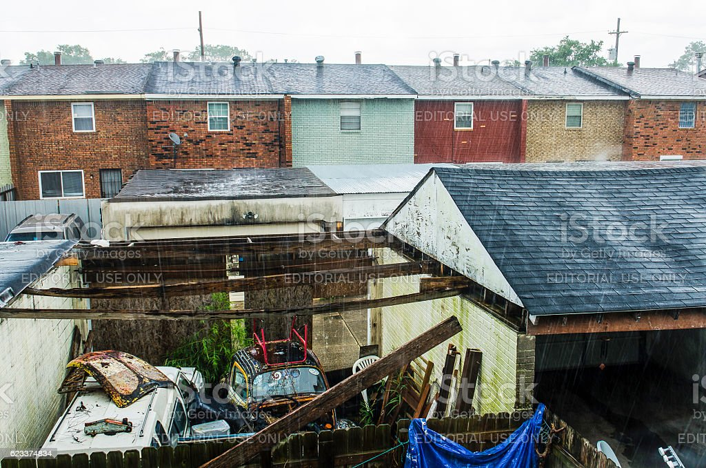 Backyard of townhome during rain with junk stock photo