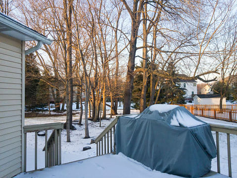 Photo of a huge backyard with snow.