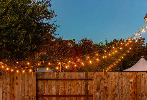 backyard party lights - garden party stock photos and pictures