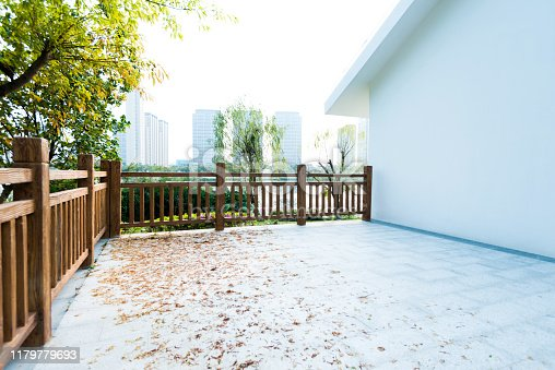 Backyard patio with trees in city.
